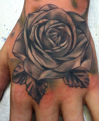 Rose On Hand by Max Estes